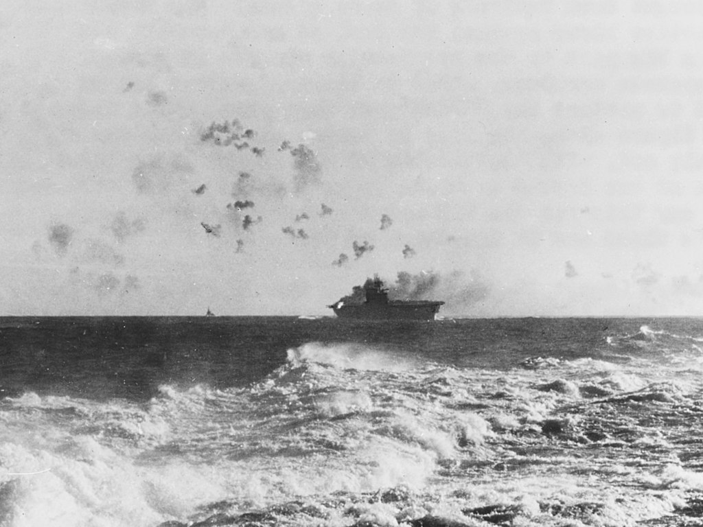 1024px-USS_Enterprise_(CV-6)_under_attack_and_burning_during_the_Battle_of_the_Eastern_Solomons_on_24_August_1942_(NH_97778)